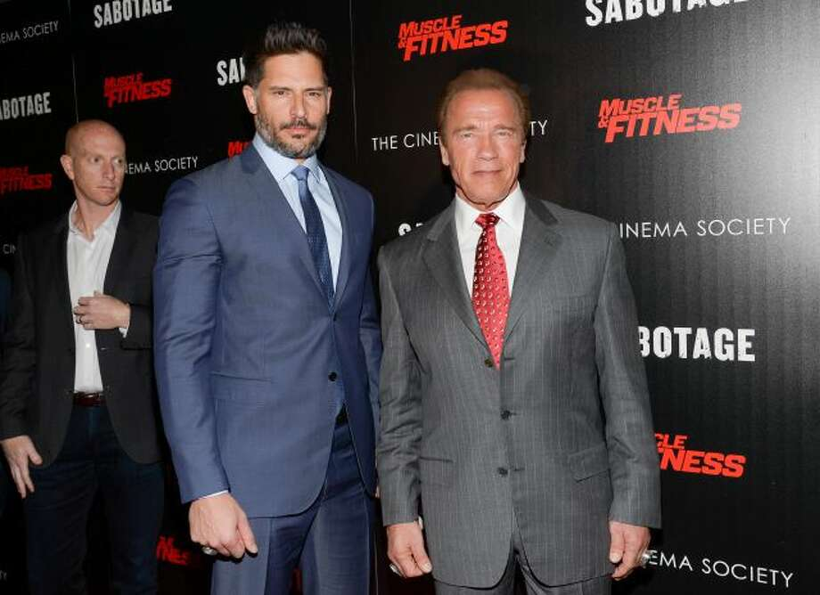 "In this Tuesday, March 25, 2014 file photo, actors Joe Manganiello, left, and Arnold Schwarzenegger attend a special screening of Open Road Films' ""Sabotage,"" hosted by The Cinema Society with Muscle & Fitness at AMC Lincoln Square, in New York. The film releases Friday, March 28, 2014. (Photo by Evan Agostini/Invision/AP) Photo: Evan Agostini/Invision/AP / Invision"