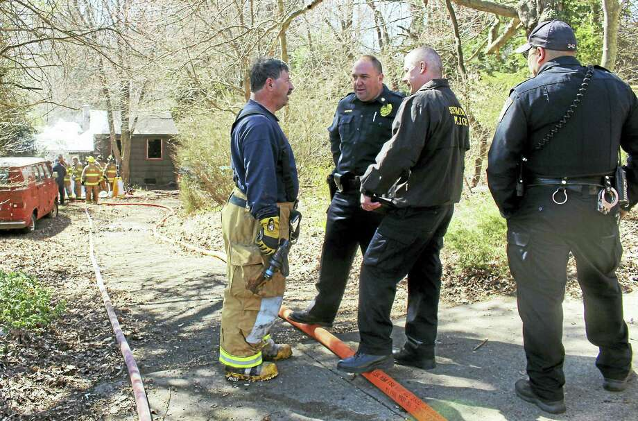 (Jean Falbo-Sosnovich/The New Haven Register) A man died Wednesday after he was pulled from a house fire at 9 Bungay Road in Seymour with a gunshout wound. Fire crews did CPR on the man and rushed him to the hospital but he did not survive. Photo: Journal Register Co.