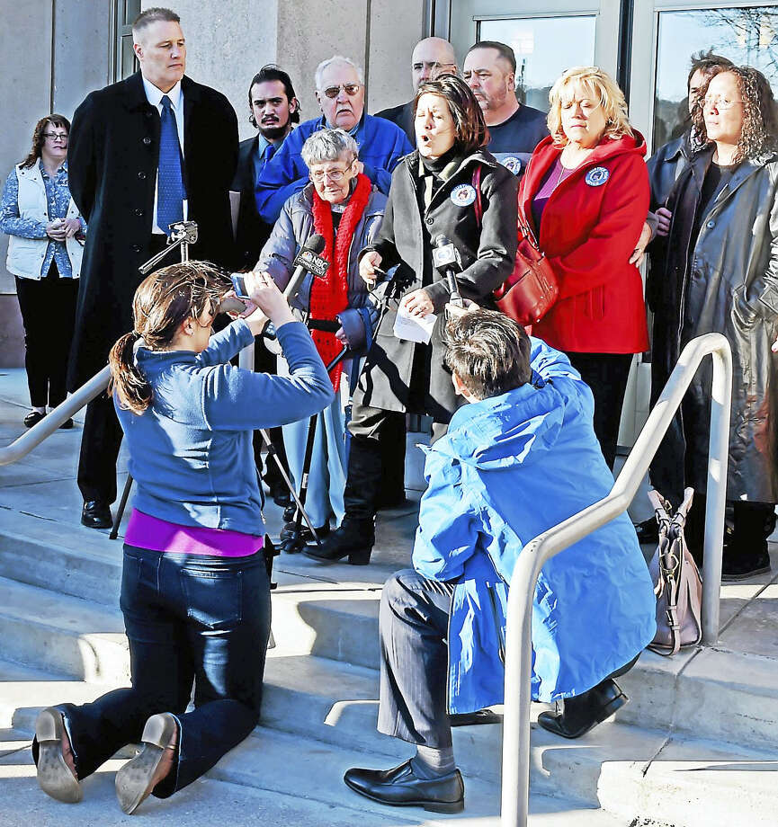 (Peter Hvizdak - New Haven Register)Marianne V. Stochmal Heffernan, with her family and Connecticut legislators, speaks on the steps of Waterbury Superior Court Thursday afternoon, March 2, 2017 decrying the Connecticut Innocence Project and the  court-ordered release from prison of David Weinberg who was convicted of murdering her sister in 1984. The release was ordered after Weinberg served 26-years of a 60 year prison sentence. Weinberg will still be classified as a murderer although the Innocence Project raised doubts about his conviction. Photo: ©2017 Peter Hvizdak / ©2017 Peter Hvizdak