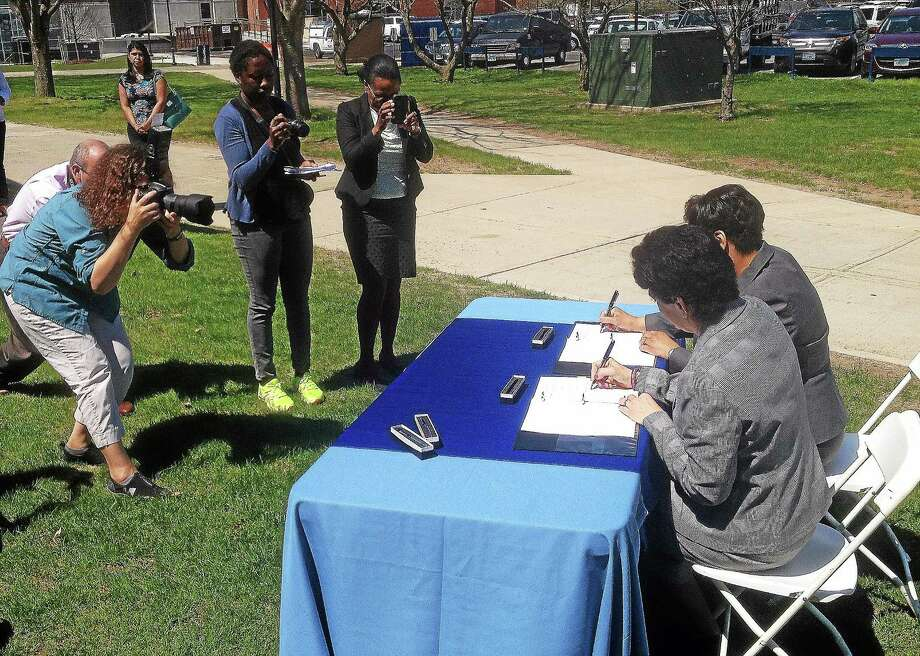 New Haven Mayor Toni Harp and Southern Connecticut State University President Mary A. Papazian on Monday signed a memorandum of understanding aimed at bolstering the region's commitment to filling STEM jobs in the growing biotech field. (Evan Lips - New Haven Register) Photo: Journal Register Co.