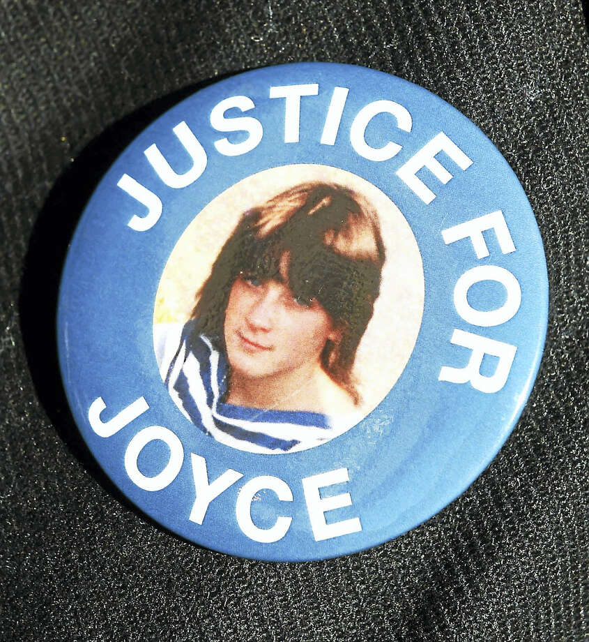 A button with a photograph of murder victim Joyce Stochmal worn by a a family member Thursday afternoon, March 2, 2017 after a judge in Waterbury Superior Court ordered the release of David Weinberg who was convicted of murdering her in 1984. Photo: ©2017 Peter Hvizdak / ©2017 Peter Hvizdak