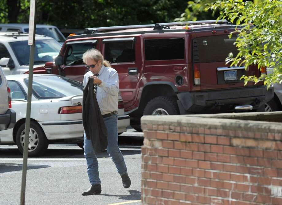 Robert Kahn of Bantam, arrives at Danbury Superior Court Friday morning. He was arrested in the April alleged attack of a man and his dog in Ridgefield. Photo taken Friday, June 11, 2010. Photo: Carol Kaliff / The News-Times
