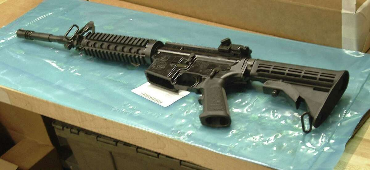 FILE - In this March 27, 2008 file photo, an M4 Colt rifle is displayed at the Colt Defense Plant in Hartford, Conn. The 179-year-old gun maker filed for chapter 11 bankruptcy on Sunday, June 14, 2015, estimating it owes up to $500 million. Analysts cite several reasons behind Colt's bankruptcy filing, including struggles to recover from the loss of military business and failure to capitalize on consumer interest in guns. (AP Photo/Richard Lardner, File)