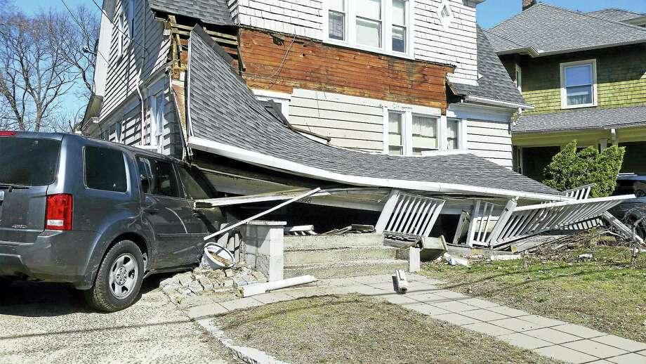 (Photo courtesy of the Hamden Fire Department) A house at 1548 Whitney Ave. in Hamden was severely damaged Tuesday morning after a SUV crashed into the front of it. Police say the SUV had been involved in an accident at Waite Street then accelerated into the house. Photo: Journal Register Co.