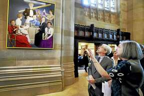 (Peter Hvizdak - New Haven Register) Yale President Peter Salovey, left, and Laura Wexler, Yale Professor of Women's, Gender & Sexuality Studies and American Studies and a Yale Women Faculty Forum (WFF) co-chair of the Portrait Project, right, gaze at a painting before an unveiling ceremony Tuesday afternoon, April 5, 2016 in the Sterling Memorial Library Nave at Yale University commemorating seven women who, in 1894,  were the first to receive Yale Ph.D.'s. The  WFF commissioned the portrait of the seven women in part to increase the portraiture of women on the Yale campus. The seven women were Elizabeth Hanscom, Mary Scott, Cornelia Rogers, Laura Wylie, Charlotte Roberts, Margaretta Palmer and Sara Rogers.