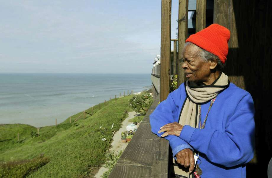 Druth McClure looks out from her deck on a cliff overlooking the Pacific Ocean in Pacifica, Calif. Crumbling cliffs have forced dozens to leave their homes and others like McClure may have to join them as EL Nino-fueled storms batter the coast. Photo: Ben Margot — The Associated Press  / AP