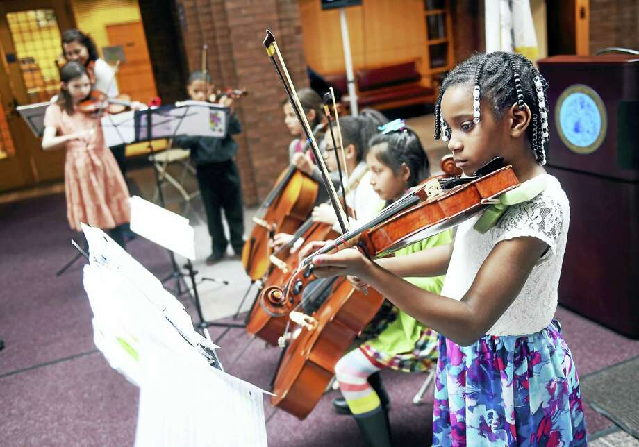 (Arnold Gold-New Haven Register)   Members of The Lanterns from Music Haven perform at the Happy Birthday New Haven! event celebrating New Haven's 379th birthday in the atrium of City Hall in New Haven on 4/24/2017. Photo: Digital First Media