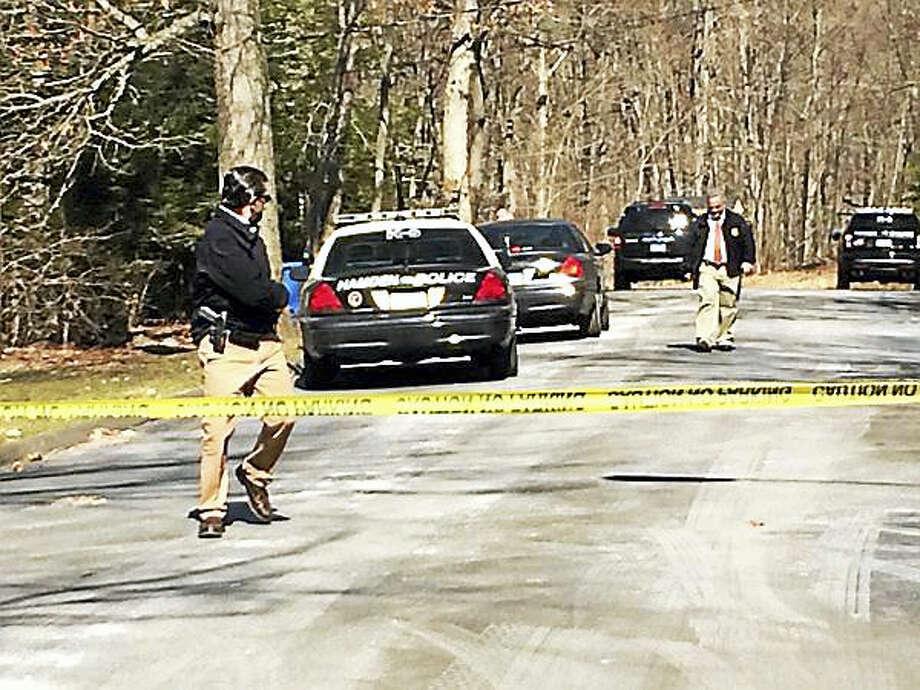 Hamden officers leave Julian Drive in Hamden. (Wes Duplantier - New Haven Register) Photo: Journal Register Co.