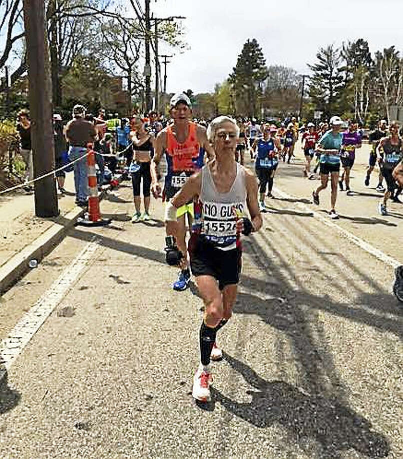 Ben Beach last Monday during the 17th mile of his 50th consecutive Boston Marathon, a record. (Contributed photo by Tom Skelly) Photo: Digital First Media