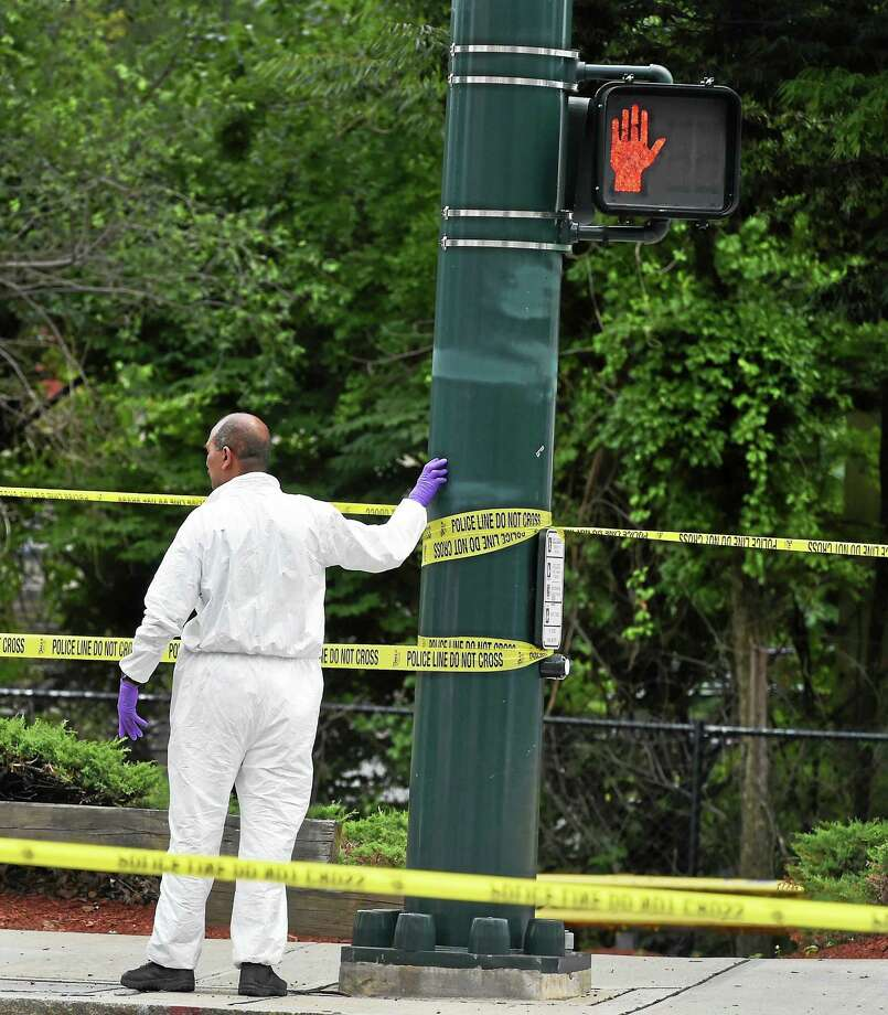 New Haven police investigate the discovery of human legs found near the State Street railroad station near Court Street in New Haven Wednesday. Photo: Peter Hvizdak — New Haven Register  / ©2015 Peter Hvizdak