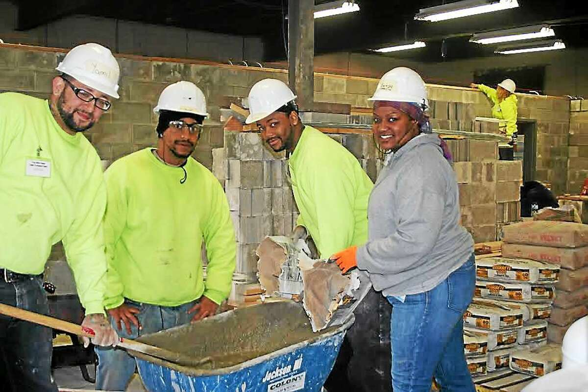 2013 2014 Students Mixing Cement to install new walls at 316 Dixwell Ave. All the brick was Donated. Contributed photo