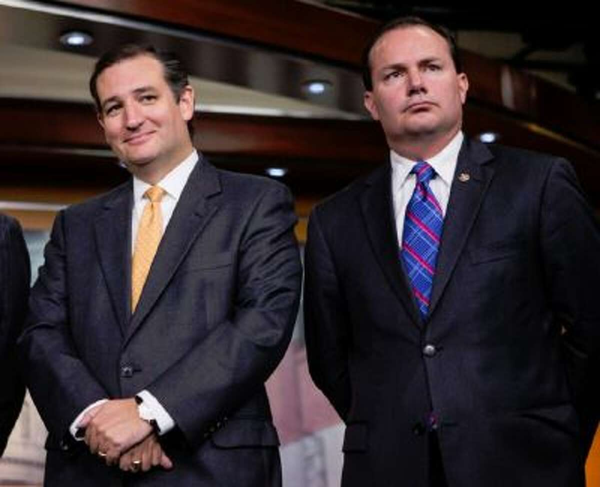 Sen. Ted Cruz, R-Texas, left, and Sen. Mike Lee, R-Utah, during a news conference with conservative Congressional Republicans at the Capitol in Washington, Thursday, Sept. 19, 2013. Cruz and Lee stand as the Senate's dynamic duo for conservatives, crusading against President Barack Obama's health care law while infuriating many congressional Republicans with a tactic they consider futile, self-serving and detrimental to the party's political hopes in 2014.
