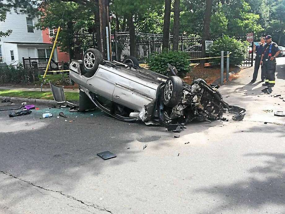 Part of Sherman Avenue was shut down in New Haven after a rollover crash late Monday morning. It  was not immediately clear if anyone was hurt in the accident. Photo: Journal Register Co.