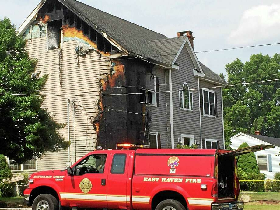 A fire Monday left major damage to a home on Maturo Drive in East Haven. Three dogs got away from fire scene without injury.  Wes Duplantier -- New Haven Register Photo: Journal Register Co.
