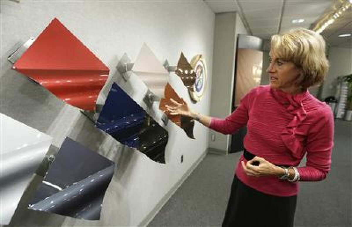 Jane Harrington, PPG's manager of automotive color styling shows off the company's color palette in Troy, Mich., Tuesday, Oct. 22, 2013.