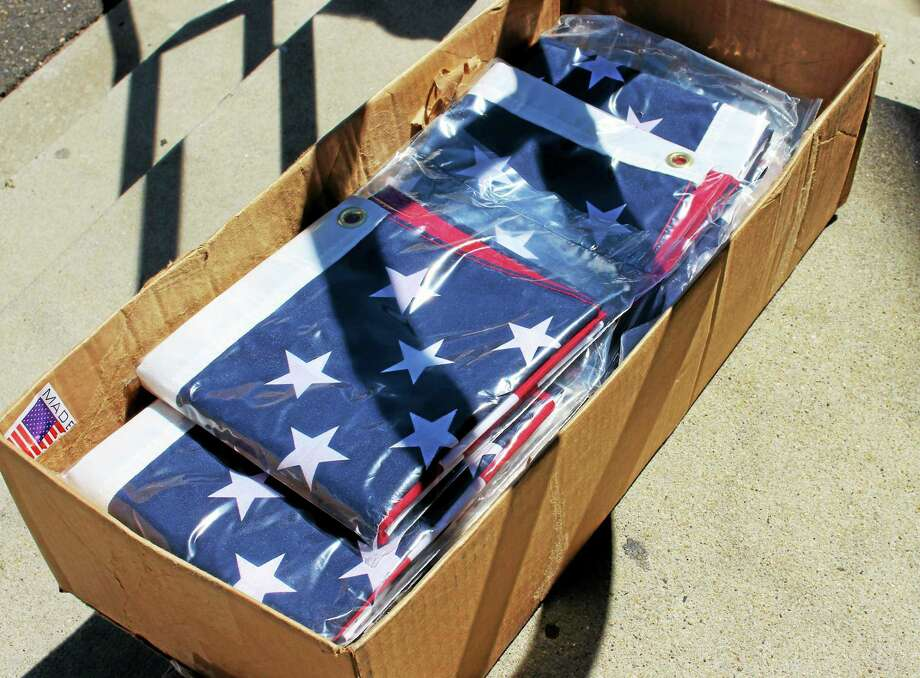 Flags that will soon line downtown Derby. (Jean Falbo-Sosnovich - New Haven Register) Photo: Journal Register Co.
