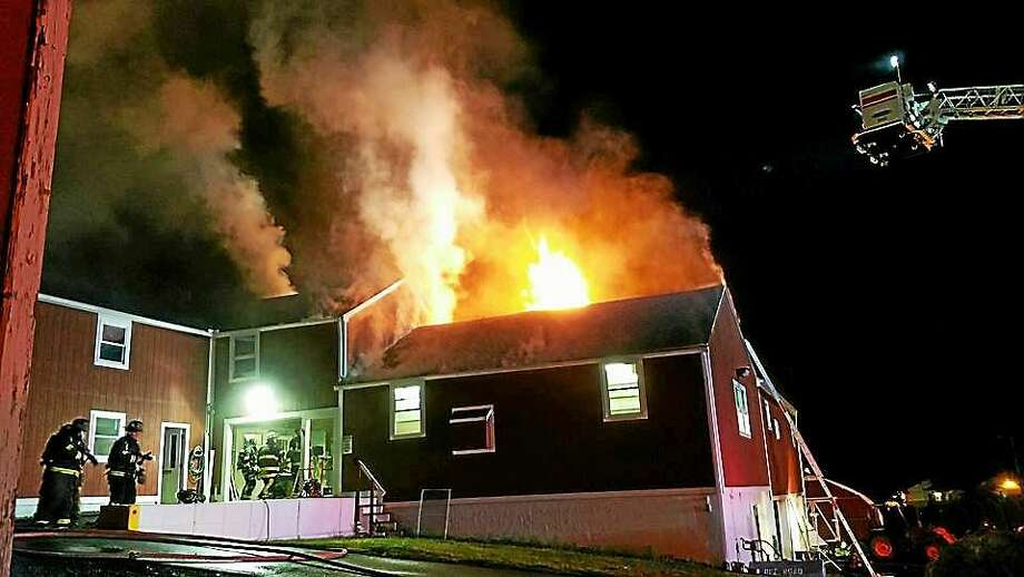 (Photo from the Cheshire Volunteer Fire Department) A fire in a maintainence barn at the Cheshire Academy sent flames shooting through the roof late Tuesday night. Crews put out the fire in about three hours. Photo: Journal Register Co.
