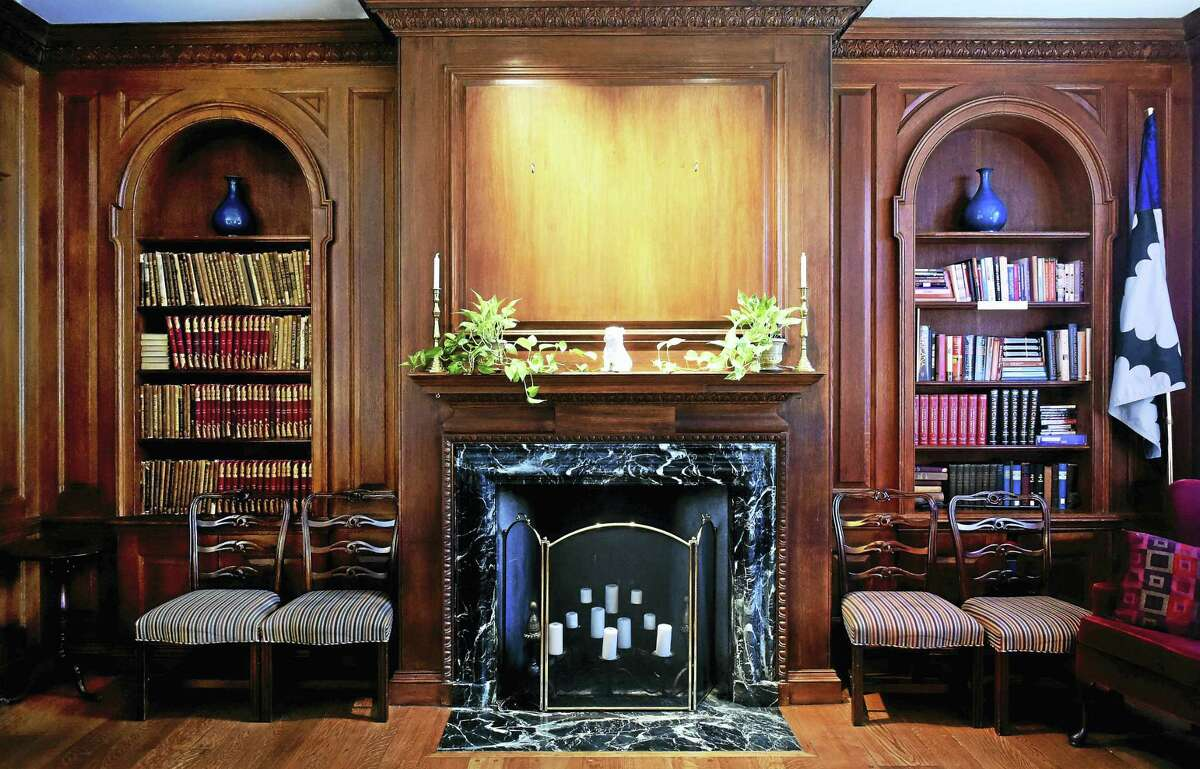 (Peter Hvizdak - New Haven Register) ¬ The space over the fireplace mantel at Yale University's Calhoun College Master's House that held the portrait of John C. Calhoun until 2016.