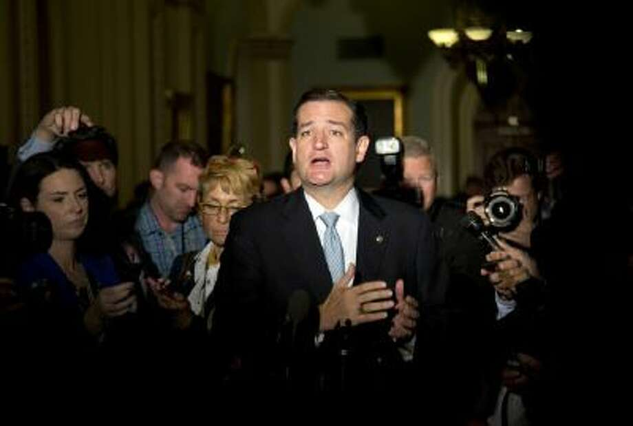 In this Oct. 16, 2013, file photo Sen. Ted Cruz, R-Texas, talks to reporters on Capitol Hill in Washington after House leaders reached a last-minute agreement to avert a threatened Treasury default and reopen the government after a partial, 16-day shutdown.