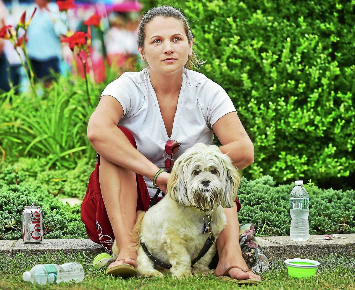(Catherine Avalone - New Haven Register) Milford resident Valerie Mallard and her dog Jake listen to Jen Durkin and the Business perform at the 3rd annual Woofstock on the Branford Green, Saturday, August 8, 2015. Woofstock is a fundraiser for the Daniel Cosgrove Animal Shelter.