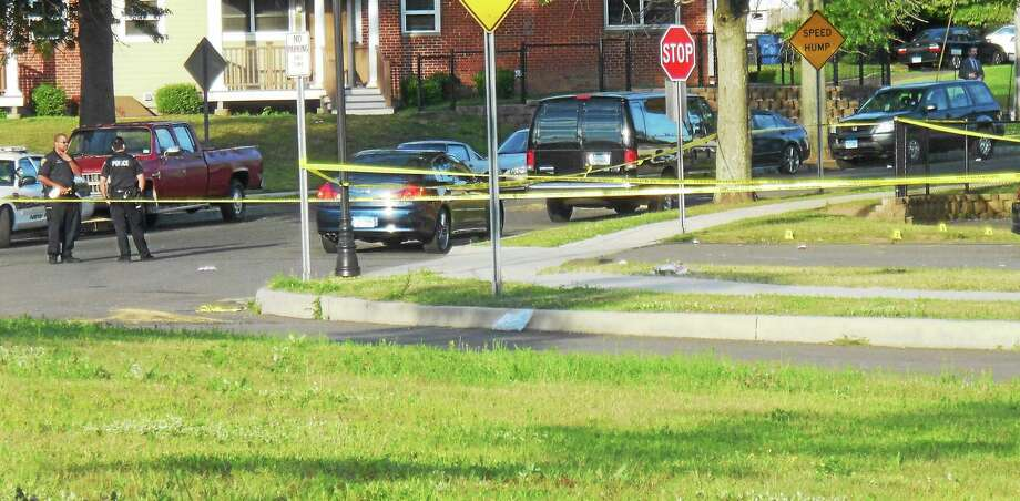 (Wes Duplantier -- New Haven Register) Bouchet Lane in eastern New Haven was blocked off Thursday morning as police investigated the fatal shooting of a city man there Wednesday night. Police are asking for the public to help them find out more about what happened. Photo: Journal Register Co.