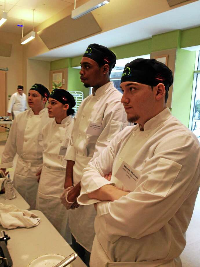 Five students from Wilbur Cross High School in New Haven will compete at a national culinary competition. From left are Abimalec Montalvo, Alexia G. Velazuez, Javon T. Phelmetta and Juan Carlos. Not pictured is Neycha M. Santiago. Photo: (Submitted Photo)
