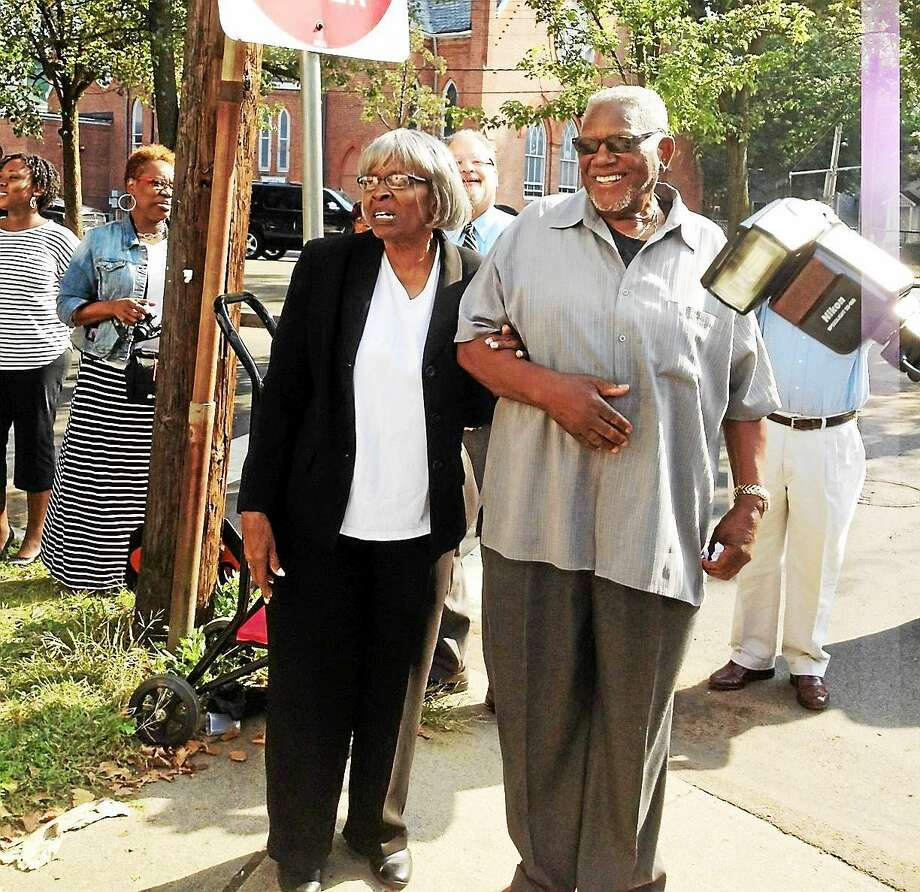 (Mary O'Leary - New Haven Register)  Mother Ethel T. Gay and Bishop J. Gay Sr. listen to cheers from the crowd in New Haven. Photo: Journal Register Co.