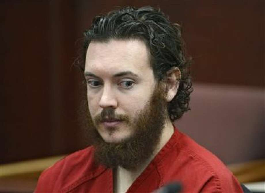 This June 4 file photo shows Aurora, Colo., theater shooting suspect James Holmes in court. His trial could last eight months, despite the large amount of evidence at hand. Photo: AP / Pool Denver Post