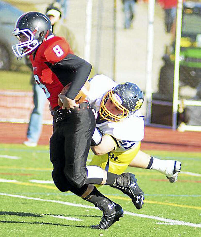 East Haven's Michael Deangelo makes a tackle in 2013 in a game against Branford. Deangelo died Wednesday in a car accident on Interstate 95 in Old Lyme. Photo: Journal Register Co.