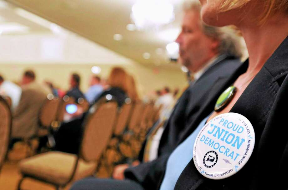 (Peter Casolino-New Haven Register)  The crowd listens as Republican gubernatorial candidate Thomas Foley speaks during a visit to the the AFL-CIO political convention at the Omni Hotel in New Haven Monday, June 16, 2014. pcasolino@newhavenregister.com Photo: Journal Register Co.