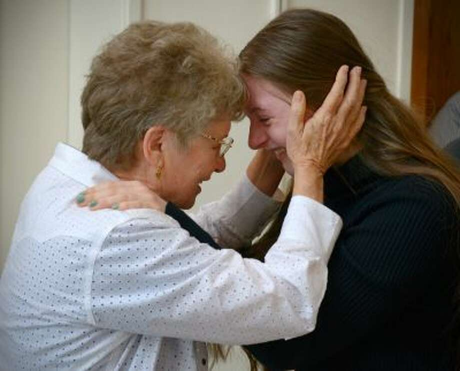Tibby Middleton, left, shares an emotional moment with granddaughter Madison Middleton on Saturday at the Unitarian Universalist Congregation of Frederick, Md. Illustrates MARRIAGE (category a), by Michael S. Rosenwald (c) 2013, The Washington Post. Moved Saturdayday, Oct. 12, 2013. (MUST CREDIT: Washington Post photo by Bill O'Leary) Photo: The Washington Post / The Washington Post