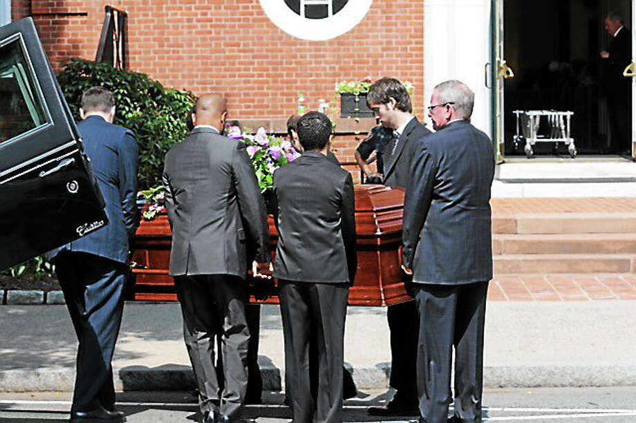 The casket being brought into the church. Mara Lavitt - New Haven Register Photo: Journal Register Co.