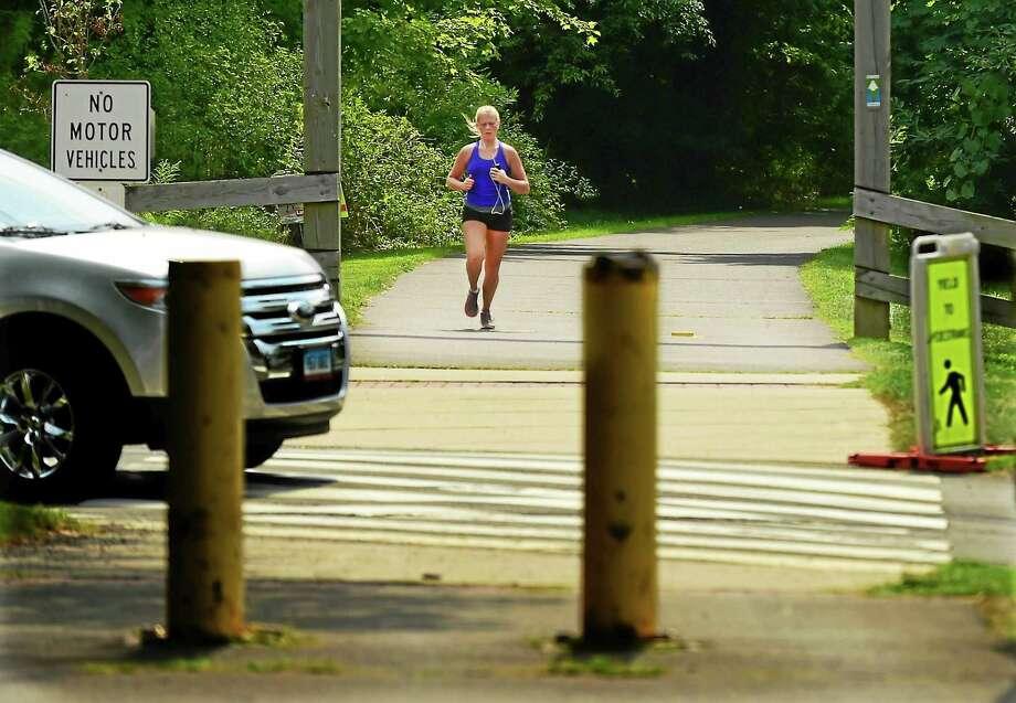 A jogger running  along the Farmington Canal Trail toward Todd Street near Whitney Ave. in Hamden Sunday August 30, 2015.(Peter Hvizdak - New Haven Register) Photo: ©2015 Peter Hvizdak / ©2015 Peter Hvizdak