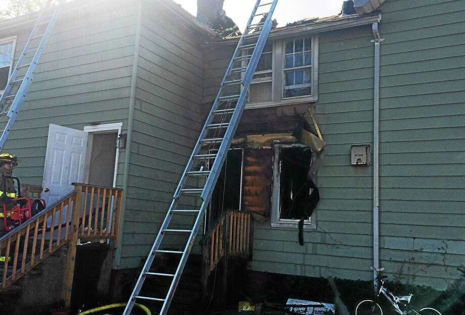 (Wes Duplantier -- New Haven Register) A dog and a cat died after a fire broke at 6 Indian Neck Ave. in Branford late Tuesday morning. Crews quickly extinguished the flames but there was extensive damage to the home and six people were displaced. Photo: Journal Register Co.