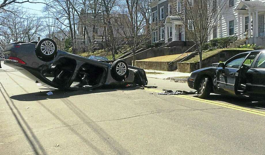 (Wes Duplantier/The New Haven Register) Part of West Rock Avenue in New Haven was shut down for more than an hour Thursday after a rollover crash between Yale and Whalley avenues. One person had to be extricated from the wreckage. Photo: Journal Register Co.