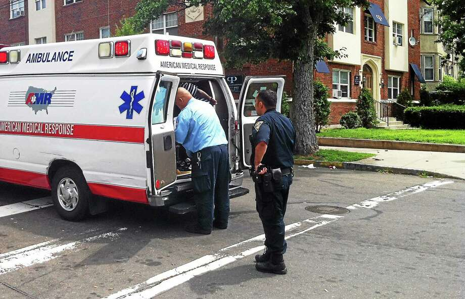 Three people were injured by knives after an altercation late Sunday morning in the area of Chapel Street and Ellsworth Avenue. Police at the scene said no one had been charged yet, but that charges were possible. (Wes Duplantier -- New Haven Register) Photo: Journal Register Co.