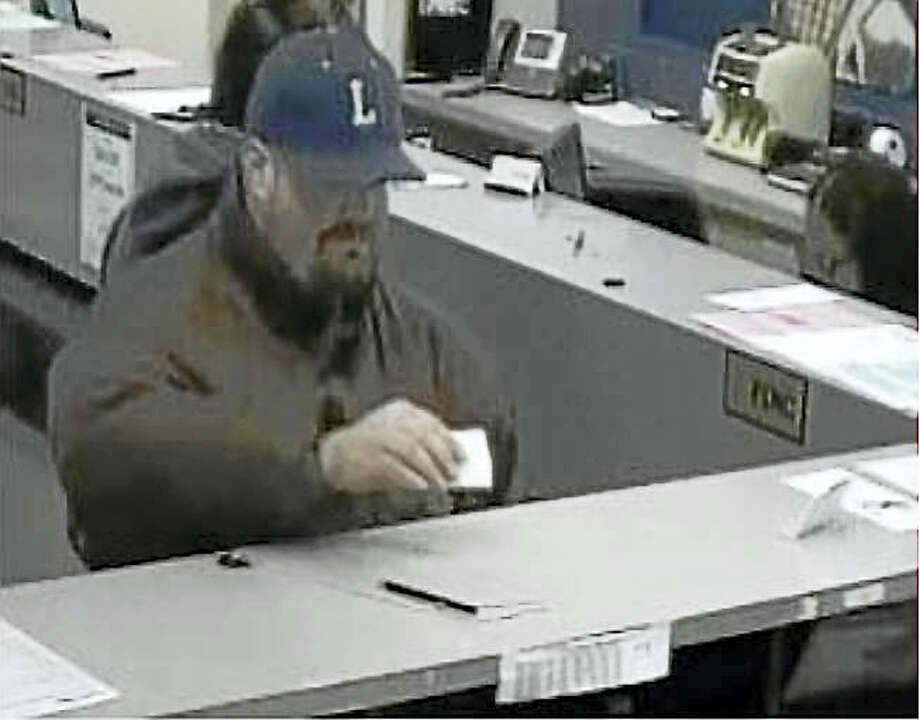 Photo courtesy of the Milford Police Department Milford police are asking the public to help them find this man who allegedly robbed People's United Bank, 190 Broad St., early Wednesday afternoon. Photo: Journal Register Co.