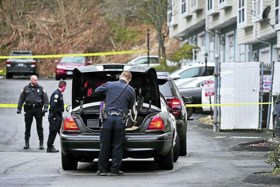 (Catherine Avalone - New Haven Register)  West Haven Police at the scene of a homicide at Colonial Ridge Apartments at 1014 Campbell Avenue in West Haven, Saturday, April 9, 2016. Police confirmed the victim is a woman and her husband has been taken into custody. Photo: Journal Register Co. / New Haven RegisterThe Middletown Press