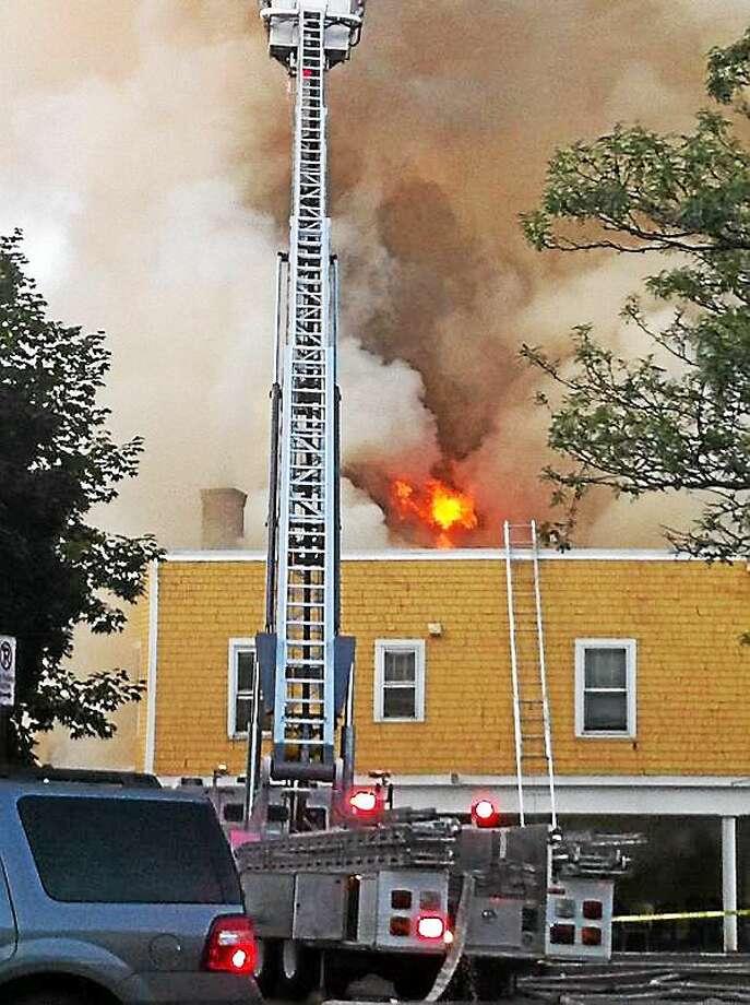 Firefighters on the scene at Delaney's Monday night. Keldy Ortiz/New Haven Register Photo: Journal Register Co.
