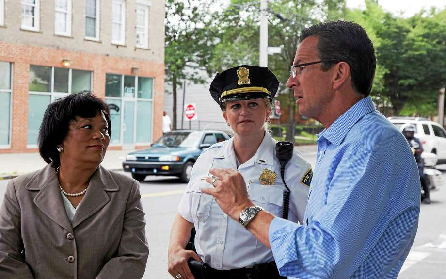 Governor Dan Malloy talks with Mayor Toni Harp and Lt. Holly Wasilewski as they take a tour through the Hill neighborhood Friday afternoon. Photo: (Rich Scinto — New Haven Register)
