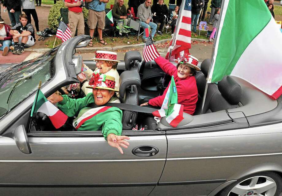 (Mara Lavitt — New Haven Register) October 13, 2013 Branford The Greater New Haven Area Columbus Day Parade rotates between six towns. This year it was in Branford. Participants included Lucille Lamberti (driver), Frances Calcetta (passenger), and Jane Malinconico (back seat). Photo: Journal Register Co. / Mara Lavitt