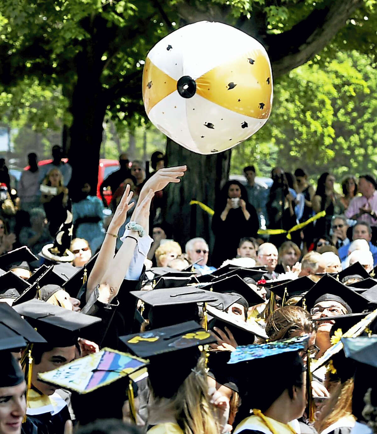 (Peter Hvizdak / Hearst Connecticut Media)Madison, Connecticut: June 19, 201. A ballon takes flight among the graduates during the Daniel Hand High School of Madison Class of 2017 commencement exercise on the lawn at the First Congregational Church in Madison.