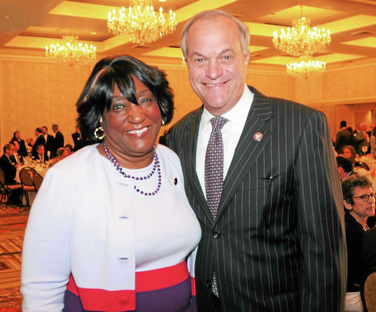 (Peter Hvizdak — Register) The Greater New Haven Chamber of Commerce honors Gateway President Dorsey L. Kendrick Ph.D. for her outstanding contribution to the Greater New Haven Community with the Community Leadership Award during an award luncheon Thursday, October 10, 2013 at the Omni Hotel in New Haven. New Haven Mayor John DeStefano, Jr., right, was also honored with the Chairman's Award from the chamber.