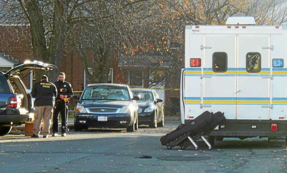 (Wes Duplantier -- New Haven Register)New Haven police blocked off Sherman Court Tuesday morning as detectives searched for clues in the shooting death of a man - who has not yet been identified -  on Monday, Nov. 16, 2015. Photo: Journal Register Co.