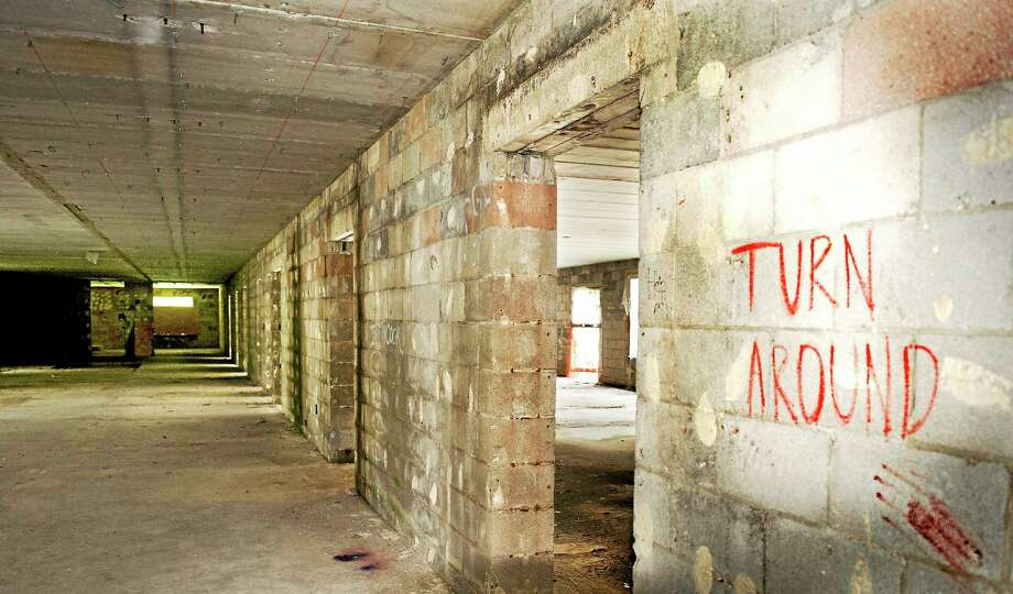 (Melanie Stengel - Register)  Cheshire abandoned properties 7/30. Graffitti on the wall of an abandoned nursing home on Hazel Drive. Photo: Journal Register Co.