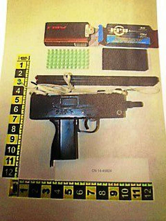 New Haven police said Monday that they had recovered at MAC-10 assault weapon during a search Friday. Police said the gun is connected to a July shootout. Photo courtesy of the New Haven Police Department. Photo: Journal Register Co.