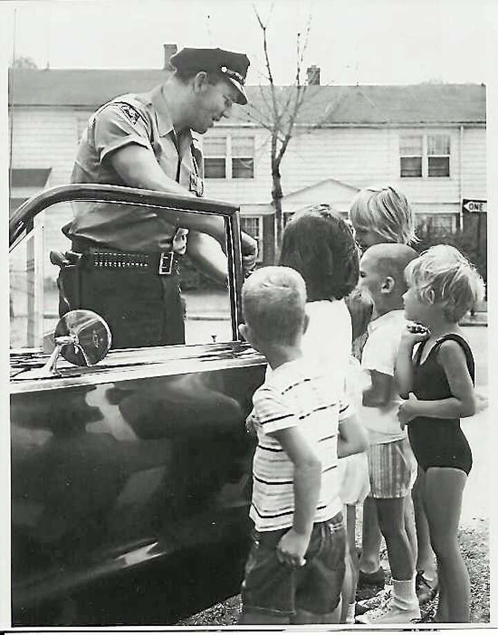 """(Contributed) Officer Bob"""" Meyerholz greeting his fan club of kids on Cooper Place in New Haven in May 1963. This was accompanied a New Haven Register feature story by an uncredited reporter, who also took the photos. Photo: Journal Register Co."""