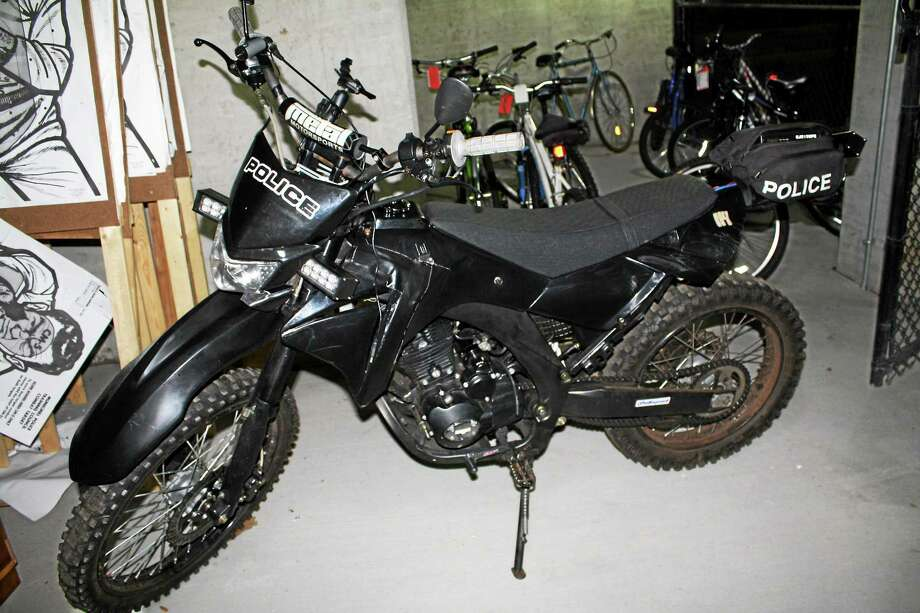 Hamden police say that 21-year-old Nicholas Ferrucci, North Haven, is facing charges after he allegedly was seen driving a facsimile police motorcycle with the word ìpoliceî written on the front, rear and side. (Photo courtesy of the Hamden Police Department) Photo: Journal Register Co.