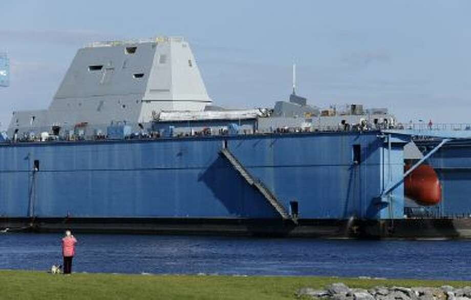 Like a giant nose, forward hull body of the first-in-class Zumwalt, the largest U.S. Navy destroyer ever built, is seen in dry dock Monday, Oct. 28, 2013, in Bath, Maine.
