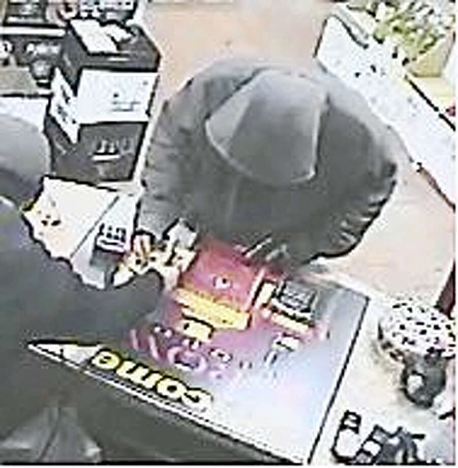 (Contributed photo) Police are on the lookout for a man who allegedly robbed the Crown Liquor store at gunpoint the day after Christmas. Photo: Journal Register Co.